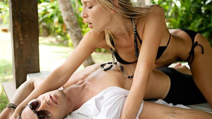 Woman initiating sexual activity with intense passion